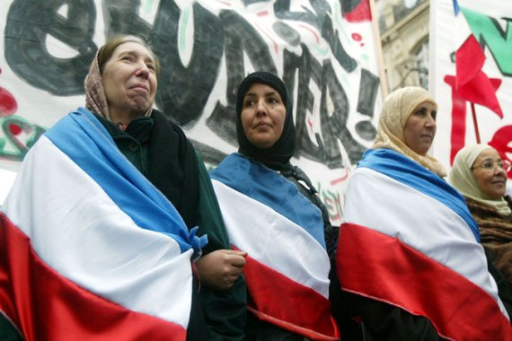 Muslim women protest French decision in 2004 barring them from wearing headscarves in state schools [Getty]
