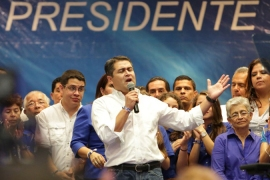 Hernandez, a conservative, has been declared victorious over his rival Xiomara Castro [AFP]