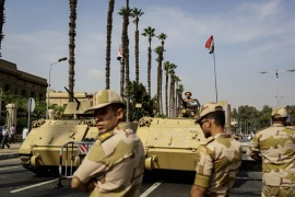 The Egyptian military tightened security ahead of former president Mohamed Morsi's trial [AP]