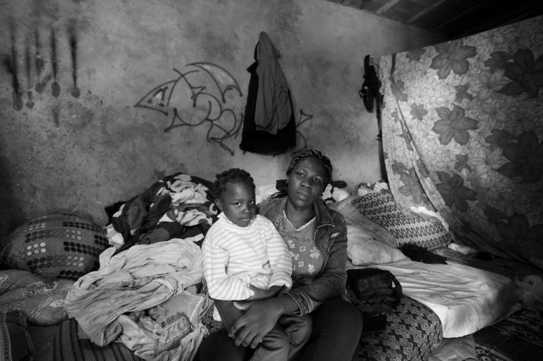 Six-year-old Deborah and her mother in their temporary home.