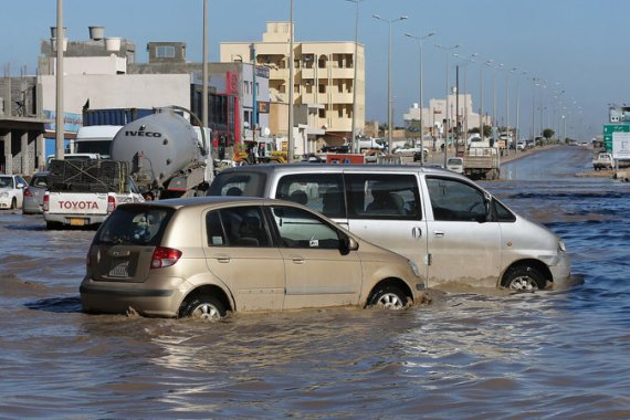 Floods hit the Libyan capital, Tripoli, blocking roads, causing power cuts and damaging several homes. [EPA]
