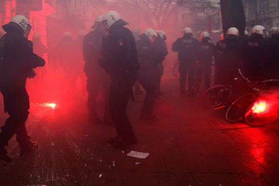 Hamburg police said some of the protesters began hurling bottles, stones and fireworks [AP]