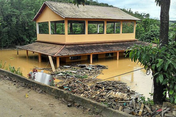 Days of torrential rain have caused widespread flooding and landslides in parts of eastern Brazil [EPA]