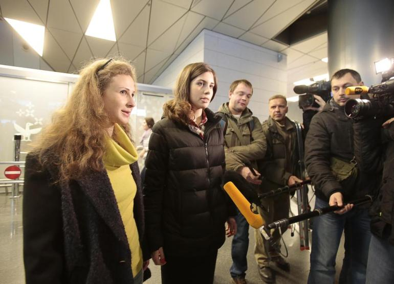 Pussy Riot members Nadezhda Tolokonnikova and Maria Alyokhina (L) talk to the media in Moscow. The musicians were released after spending two years in a Russian prison.