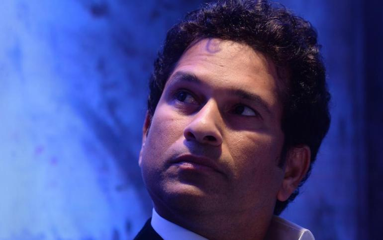 Recently retired Indian cricketer Sachin Tendulkar looks on during a function announcing him as a UNICEF Regional Ambassador in Mumbai on November 28, 2013.