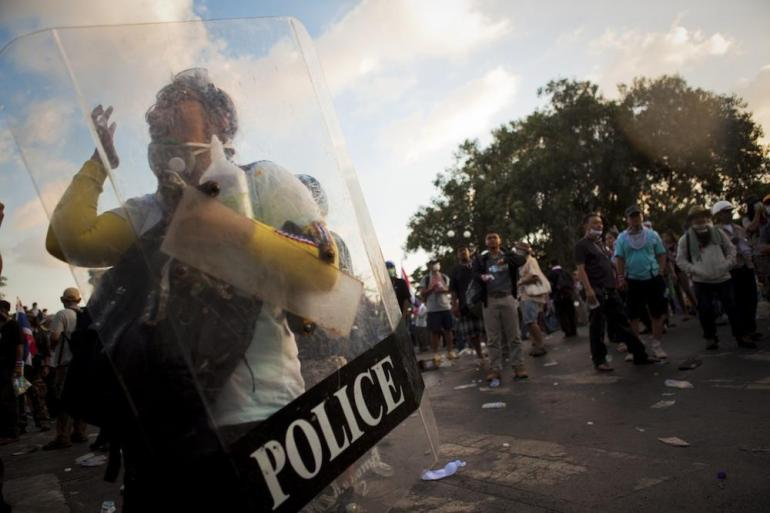 Police fired water cannons and tear gas at demonstrators, who were trying to breach barricades around government buildings.
