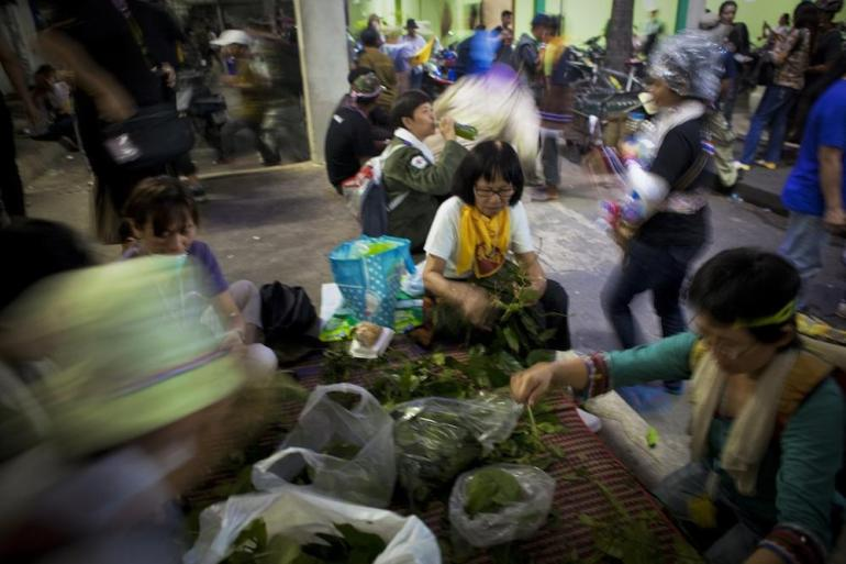 At a makeshift treatment center near the democracy monument, protesters prepared herbal medicinal drinks.
