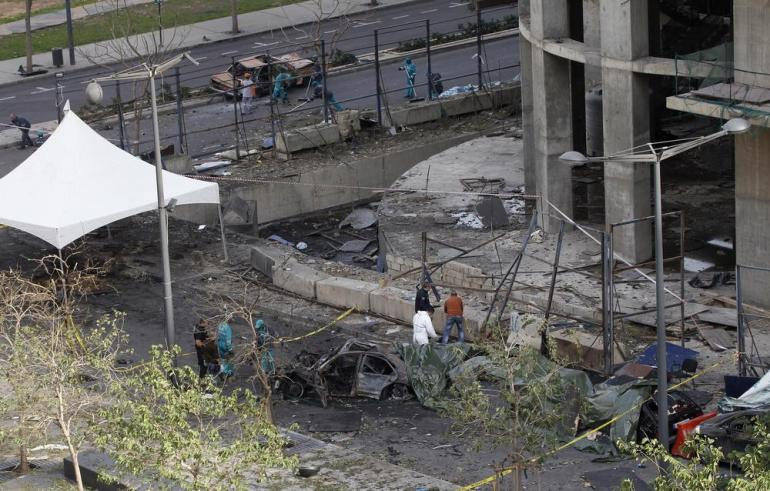 Lebanese police forensic experts inspect the scene of a powerful car bomb explosion that rocked central Beirut. Ex-premier Saad Hariri(***)s top aide Mohammad Chatah, 62, and five other people were killed in the explosion and dozens were wounded.