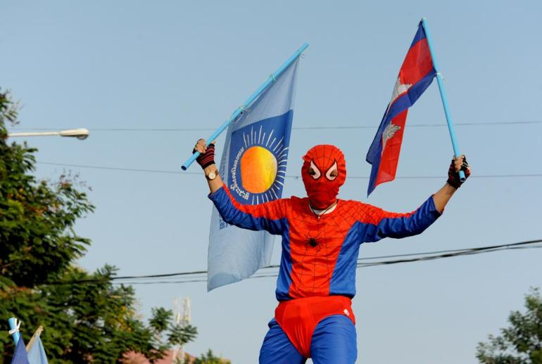 A Cambodian opposition supporter dressed as Spider-man stands on a tuk tuk during demonstrations in Phnom Penh.
