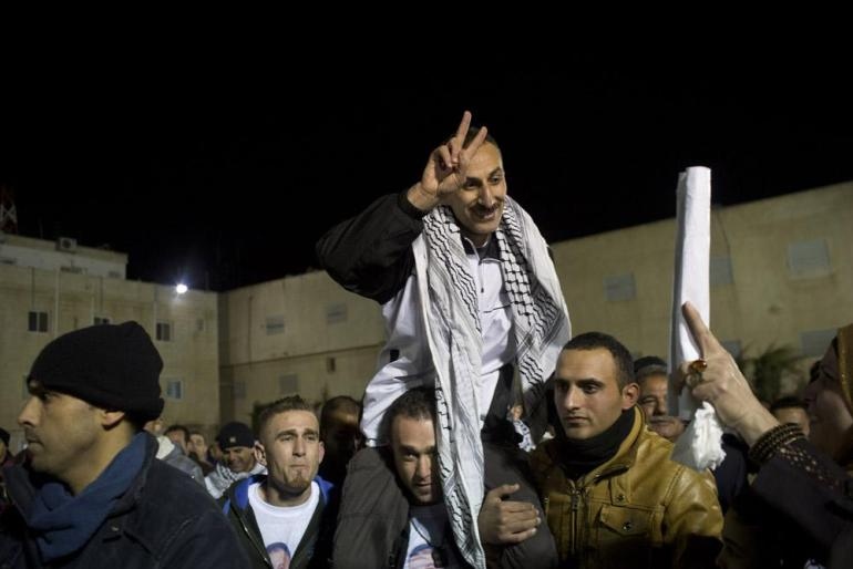 Freed Palestinian prisoners are greeted as they arrive at the Mukata Presidential Compound in the early hours on December 31.