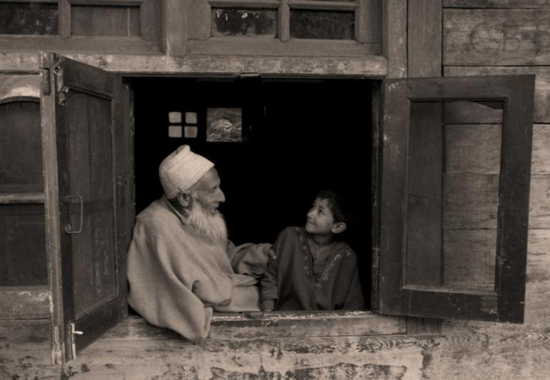 An old man with his grand daughter in a village in Ganderbal, one of the worst affected zones in Northern Kashmir