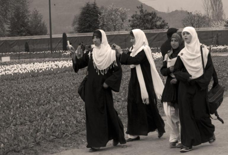 School girls take pictures of the Tulip Garden at Sirajbagh in Srinagar.