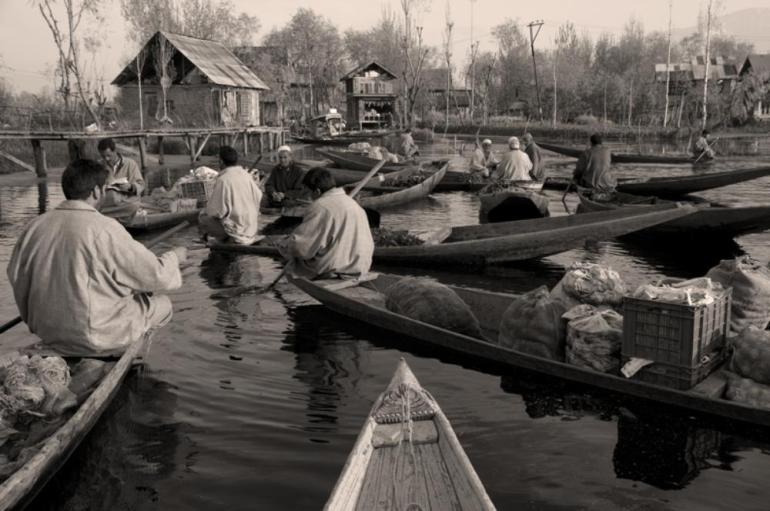 The vegetable market on the Dal Lake gets busy every morning. It normally remains active even during curfews.