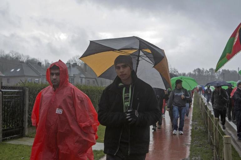 The march continued despite heavy rains and winds.