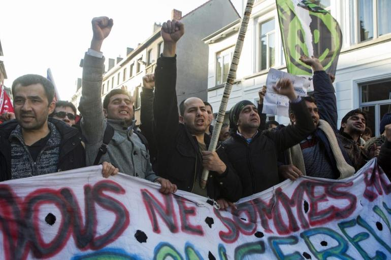Protesters marched through Ghent, shouting slogans.