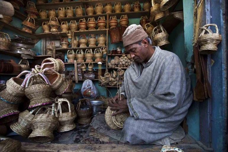 A Kashmiri man makes a kangri inside his shop in Srinagar, the capital of Indian-administered Kashmir.