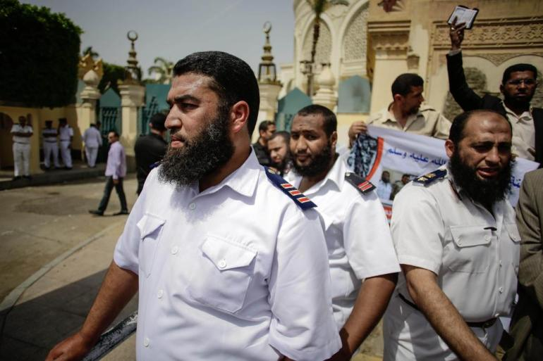 Bearded police officers rally in front of the presidential palace demanding the ability to work with beards - against the Mubarak-era bylaws aimed at exerting control over the Muslim Brotherhood - on April 28, 2013.