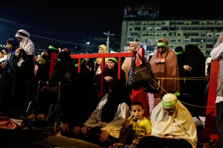 Female members of the Muslim Brotherhood pray on July 14, 2013, as they take part in a weeks-long sit-in vigil in Rabaa al-Adaweya square. The vigil followed the military overthrow of President Mohamed Morsi, who was held in an undisclosed location. It was the first time that female and male Brotherhood members staged a joint sit-in, sleeping side by side in the streets.