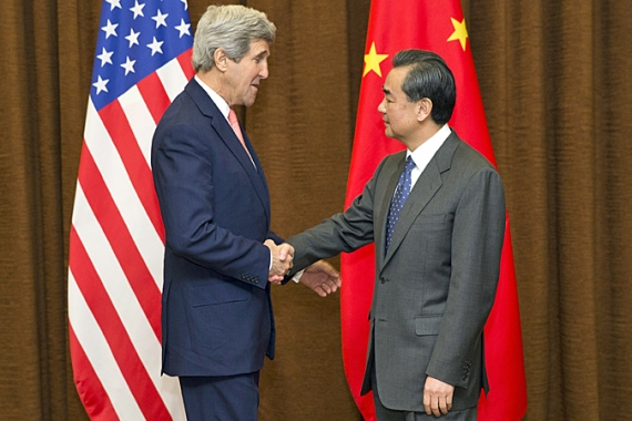 Kerry arrived in Indonesia shortly after the US and China announced steps to curb greenhouse gases [AP]
