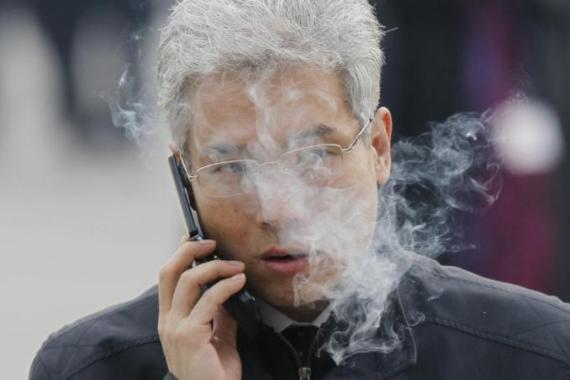 China has banned its officials from smoking in public to set an example to the rest of the country [AP]