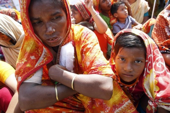 Garment workers injured in the Rana Plaza building collapse have demanded compensation [Reuters]