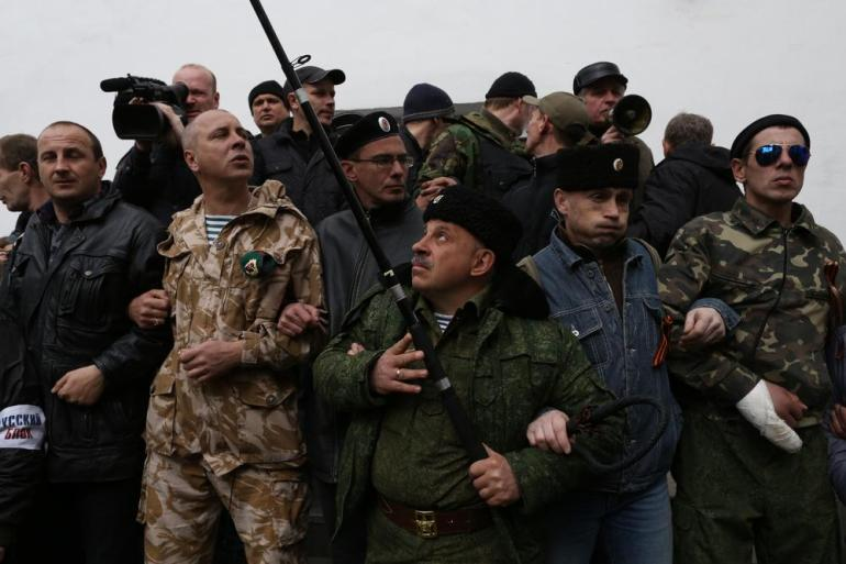"Crimean ""self-defence"" forces blocked the entrance to navy headqurters while negotiations between Ukranian navy officers and pro-Russian forces took place."