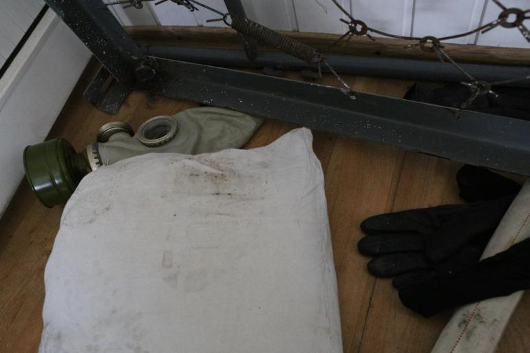 A gas mask and gloves left by Ukranian officers lays inside the Ukranian navy headquarters.