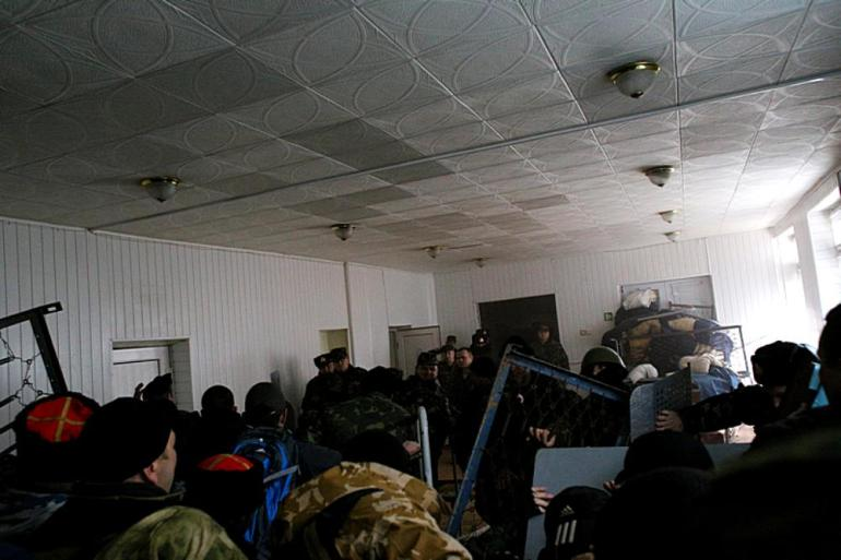 "Crimean ""self-defence"" forces break into a building at Ukranian navy headquarters."