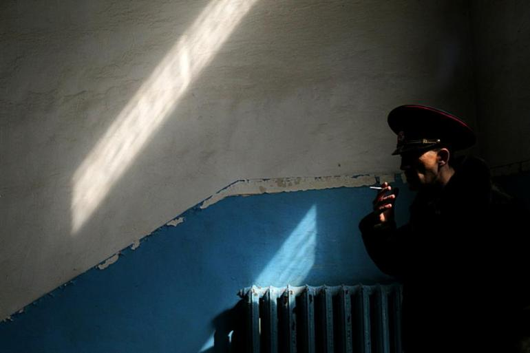 A man smokes inside one of the buildings of Ukranian navy headquarters.