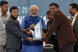 Narendra Modi, centre, is presented a memento at a business conclave organised by Muslim businessmen [Reuters]