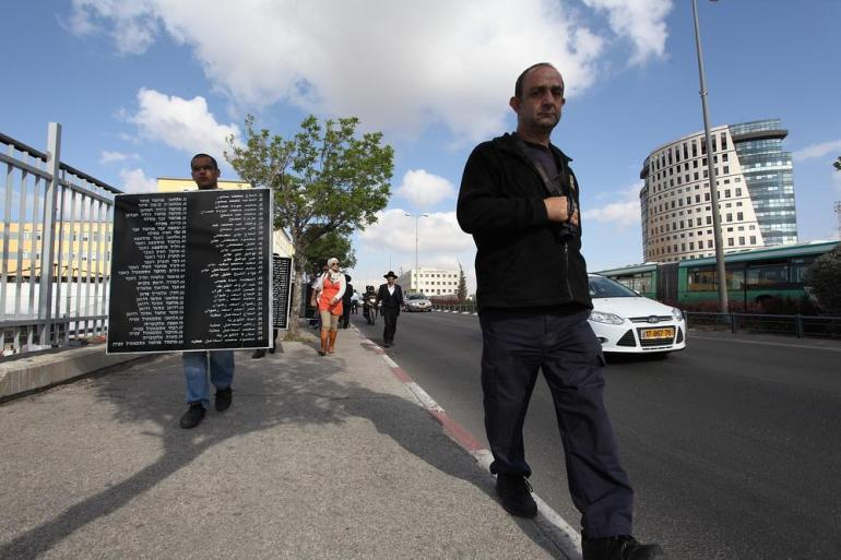 Members of the Israeli security services flanked and filmed the memorial tour, which has been confronted by extreme Zionist groups in the past.