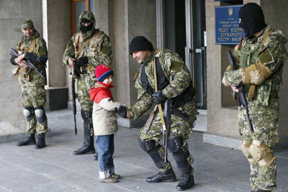 Armed pro-Russia separatists still remain outside government buildings despite calls for them to leave [Reuters]