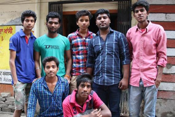 Youth group work to spread anti-drug message in neighbourhood with Master Ajit [Toral Varia/ Al Jazeera]