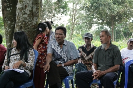 Ethnic Dayak villagers discuss encroachment by palm oil companies on their land [Dana MacLean/Al Jazeera]