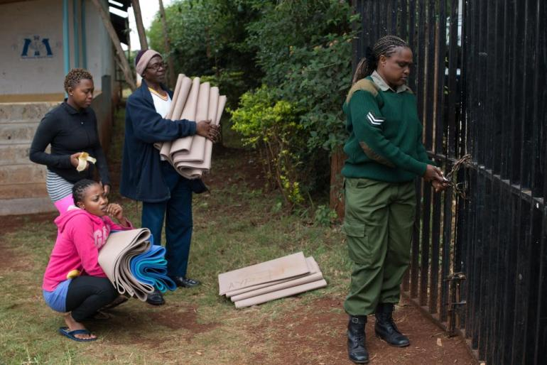 Margaret Njeri, 23, and her assistant Catherine Nyambura, 20, wait to leave Langata Women Prison after a yoga class.