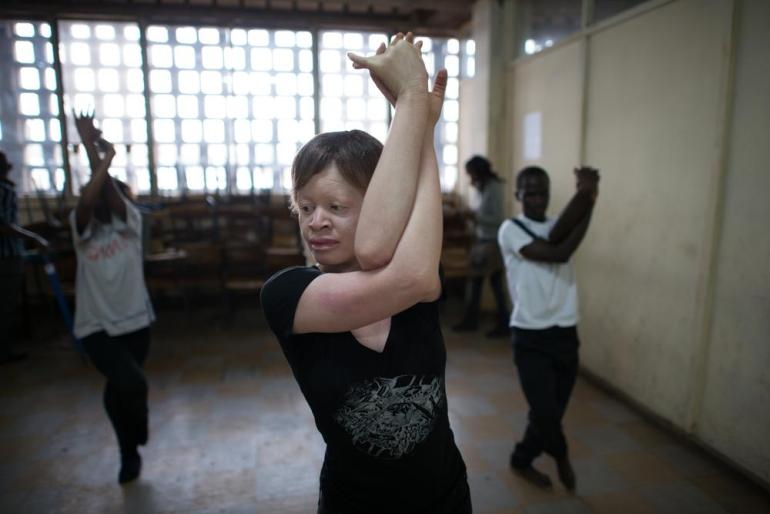Sarah Neilesa, 21, stretches during one of her first yoga classes as teacher at the Nairobi Aviation College. Sarah is affected by albinism but says she feels empowered through yoga.