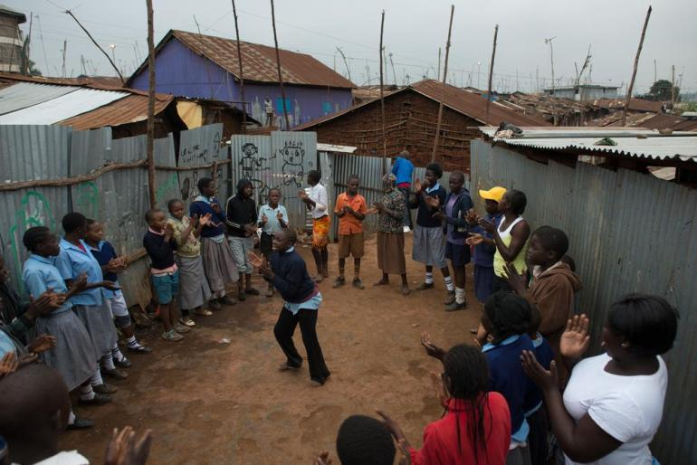 Children play a game during yoga class at the Kibera Hamlets School.