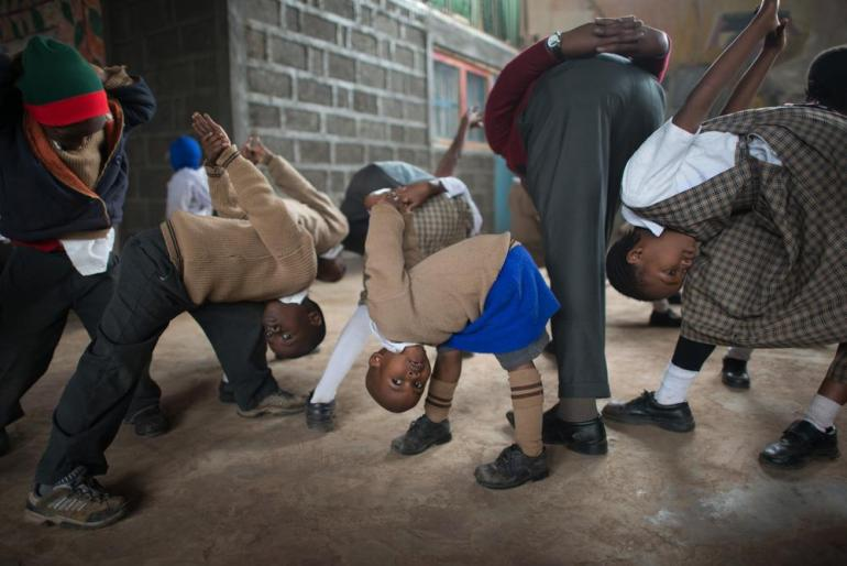 Children stretch during a yoga class at the Hafra Hope Academy in the Kangemi slum.