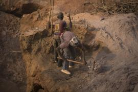 <p>Two young boys dig pits at an artisanal gold mining site in southern Mali. Their fathers also work at the mines. Many parents encourage their children to work in order to contribute to household finances. </p>