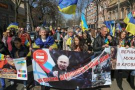 Ukrainians carry anti-Russian placards during a march in Odessa, Ukraine [EPA]