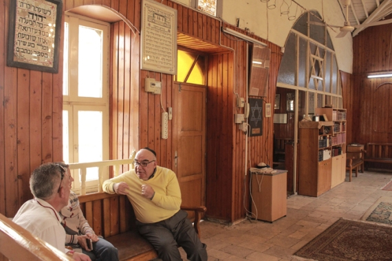 Synagogue caretaker Harun Cemal, 60, gives tours to visitors in Antakya [Danya Chudacoff/Al Jazeera]