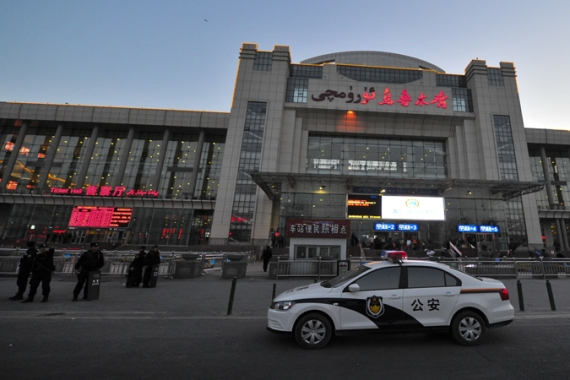 Three people were killed in an attack on a train station in Xinjiang, where most of the Muslim minority lives  [EPA]