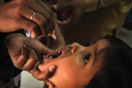 The WHO has imposed travel restrictions on Pakistanis after a spike in polio cases [EPA]