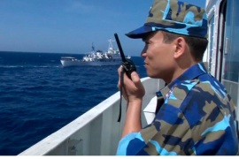 A Vietnamese Coast Guard officer monitors Chinese ships in the South China Sea [Reuters]