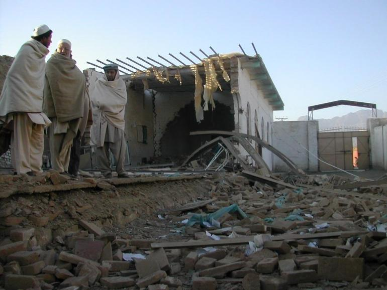 Teachers stand on the rubble of a school in Shalman village after an attack. According to Ahmad Khan, principal in one of the schools in the region, students were pulled out of their school after the attack and teachers resigned after receiving threats from rebels. Fearing more attacks, he closed the school.