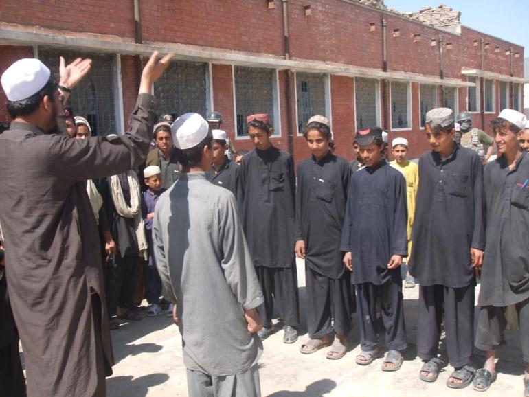 Students attend class in the open air in the remote area of Tirah Valley in Khyber tribal agency of FATA, where security forces re-opened educational institutions after five years.