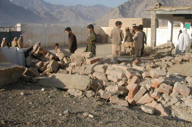 Children look at the ruins of their school that was blown up by armed groups in Azam Khel village near the Torkham border crossing between Afghanistan and Pakistan. According to the federally administered tribal areas, FATA, secretariat, more than 450 educational institutions - including dozens of schools for girls - have been bombed since 2008.