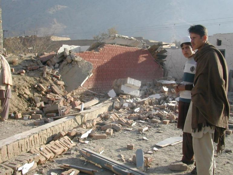 Students visit the ruins of their school in Sultankhel village in FATA.