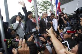 Thailand's Prime Minister Yingluck Shinawatra was ordered by a court to step down in a divisive ruling that handed a victory to anti-government protesters [AP]