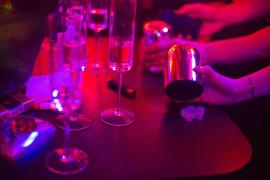 Young people play a drinking game with dice at Linx, a new nightclub on Huaihai Road. Linx is marketing itself as Shanghai(***)s most exclusive nightclub - a (***)Royal Members Club(***), with links to the Royal Monaco Yacht Club.